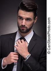 young man elegant suit necktie knot