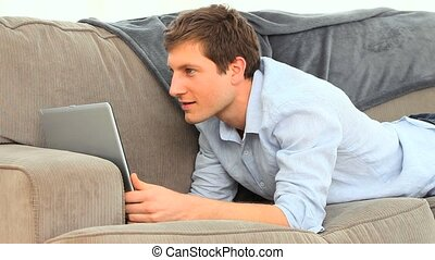 Young man enjoying a chat on his laptop