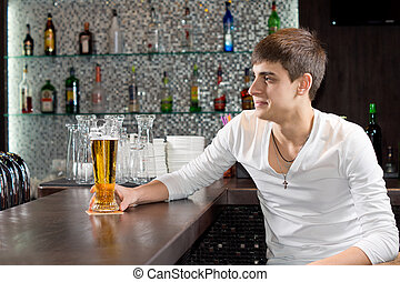 Young man enjoying a relaxing evening at the pub