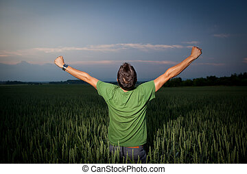 Young man enjoying his freedom/rejoicing from his success