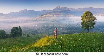Young man enjoying sunrise in the mountain village