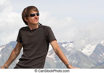 Young man enjoying the mountains