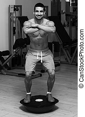 Young Man Exercising - Bosu Balance Ball
