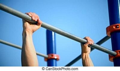 Man Exercising On Horizontal Bar