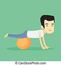 Young man exercising with fitball.