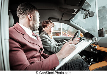 Young man feeling excited before getting his driving license
