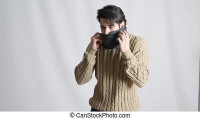 Young man feeling very cold, wearing scarf - Young man...