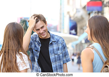 Young man flirting with two girls