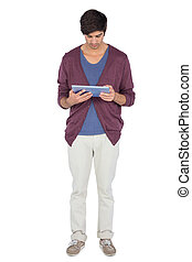 Young man focused on his tablet pc