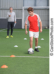 Young man football training