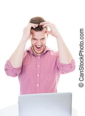 Young man frustrated with the laptop, isolated on white background