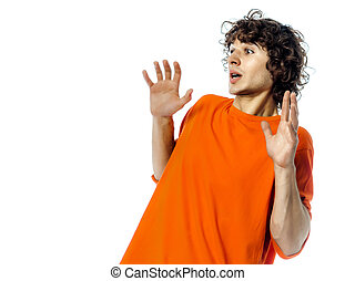 young man gesturing surprised fear afraid portrait - one...
