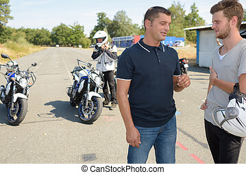 young man gets ready to start exercise on the motorbike