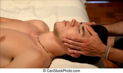 Young Man Getting Head and Face Massage - High Angle View of...
