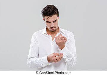 Young man getting ready in shirt