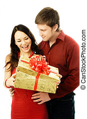 young man giver a present to his wife