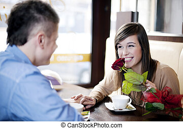 Young man giving a rose his girlfriend