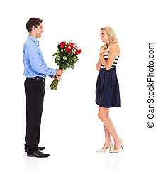 man giving bunch of roses to a girl