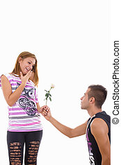 young man giving girl a rose