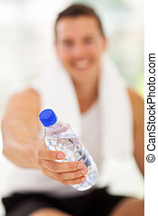 young man giving water bottle