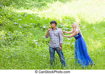 Young man have fun with girlfriend outdoors