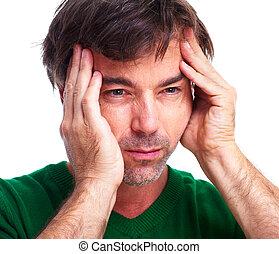 Young man having a headache.