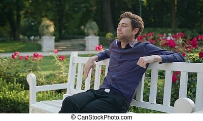 Young Man Having a Rest in the Park