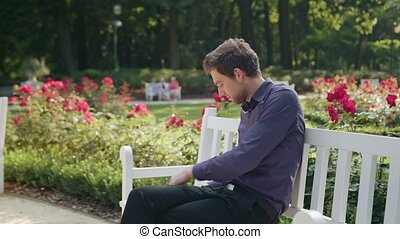 Young Man Having a Snack in the Park