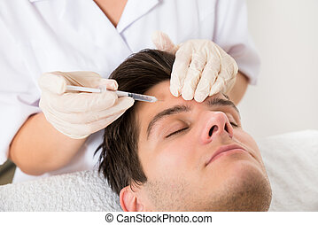 Man Having Botox Treatment - Young Man Having Botox...