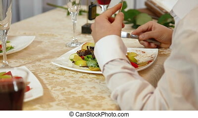 man having dinner at a restaurant