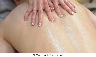 Young Man Having Relaxing Back Massage in Spa