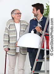 young man helping older woman