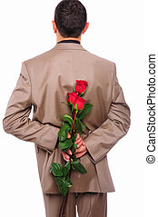 young man hides behind a rose