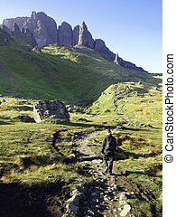 Young man hiking in the mountains