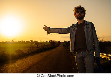 Hitchhiking - Young Man Hitchhiking on a Country Road