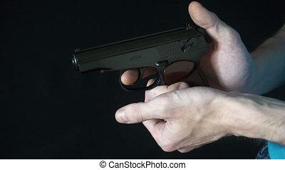 young man holding a black gun