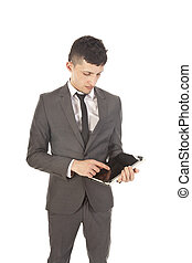 Young man holding a black tablet isolated on white