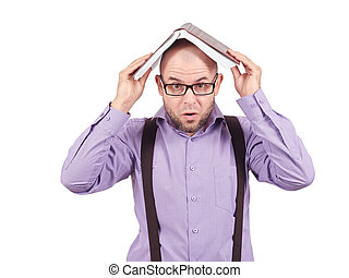 young man holding a book over his head