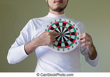 young man holding a dartboard