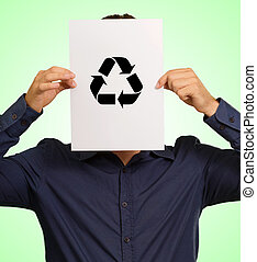 Young Man Holding A Recyclable Symbol In Front Of Face