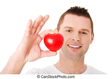 Young man holding a red heart