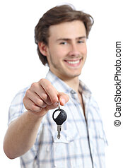 Young man holding a rental car key