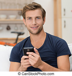 Young man holding a smartphone