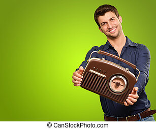 Young Man Holding A Vintage Radio