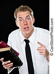 Young man holding bibles and pointing