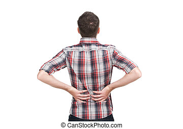 young man holding his hand to his aching back. Man holding back because of lower back pain