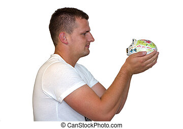 Young Man Holding Piggy Bank