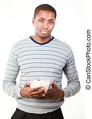 Man holding pop corn
