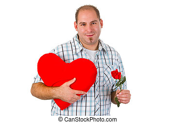 Young man holding red heart
