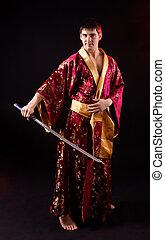 man holding samurai sword